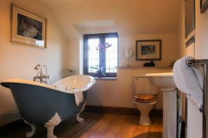 Take a soak in the freestanding slipper bath, with separate shower.