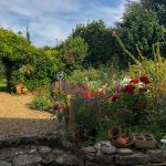 Heading outside from the kitchen you will find a country garden with table and chairs. it's the perfect space to enjoy a meal, or perhaps drinks in the evening. Leading on from here is a small orchard and a summer house.