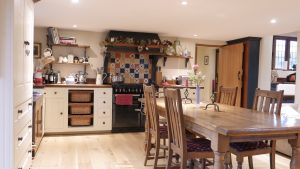 The country kitchen is open and spacious this delightful room is an inviting space for the whole family to enjoy and is well-equipped with an electric oven and gas hob, fridge/freezer, microwave, dishwasher and washing machine.